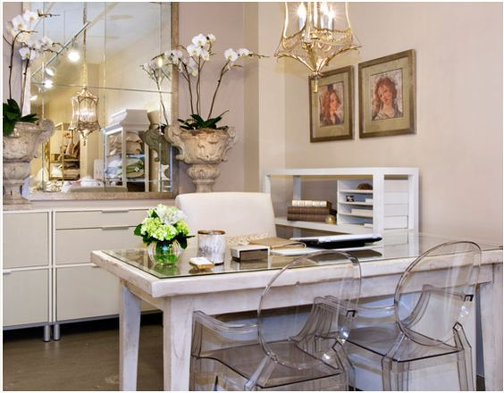 office space, love the orchids and lucite chairs