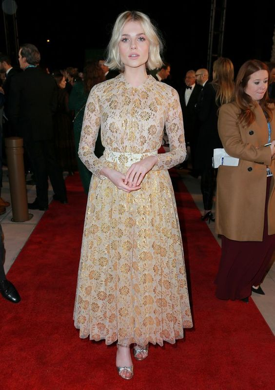 Lucy Boynton Style: Lucy tends to gravitate towards full skirting—we love how she's kept her beauty pared back with this '50s style, belted midi.