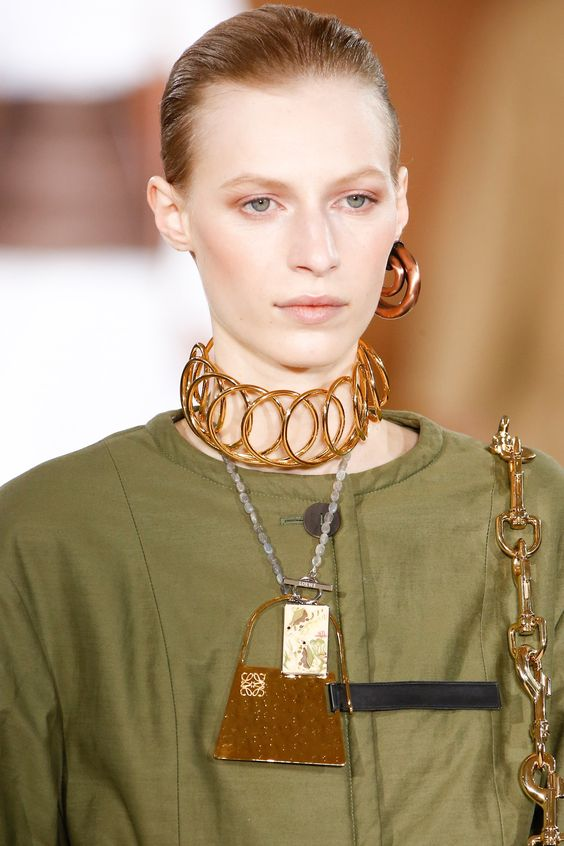 Are you sporting an armful of metal bangles in the style Man Ray's muse Nancy Cunard (with the earrings and choker to match)? Well, you should be