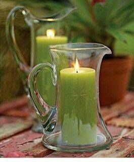 Pillar candle in pitcher