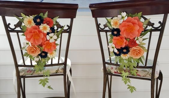 A fabulous way to decorate your next event. These can be used on chairs, pillars or pews. These would also look great tied back with tulle hanging from a trellis. This listing is for a set of TWO customized arrangements to match your color scheme. Please contact me for current lead times. Flowers that are used in the arrangements, measure between 5.5 - 2.5. Each arrangement comes with long tails of silk ribbon so they can be tied to your structure. Please do not hesitate to contact me with…