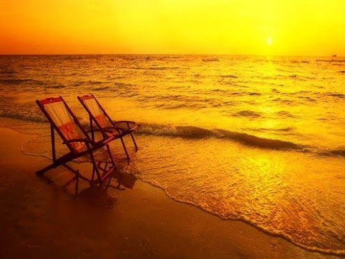 take a walk on the beach, under the sunset