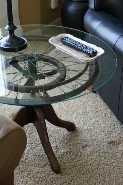 Table made from wheelchair wheel and a stool