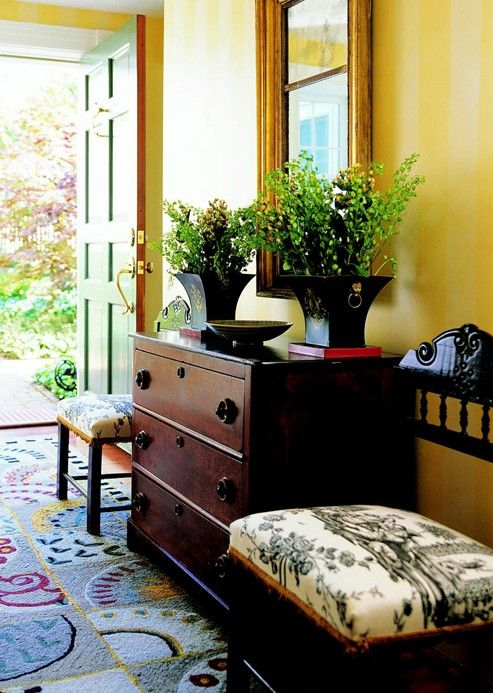 Love the Yellow walls and the dark wood in the furniture.