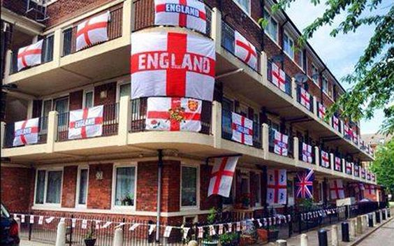 Coming together: Residents of an estate in an area known as The Blue in Bermondsey, south-east London, have turned it red and white after smothering the outside of their homes in St George's flags