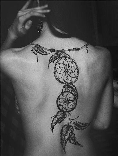 tatoo feminina nas costas: