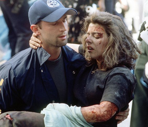A U.S. marshal helps a woman after she was injured in the terrorist attack on the World Trade Center in New York, in this Sept. 11, 2001 photo.