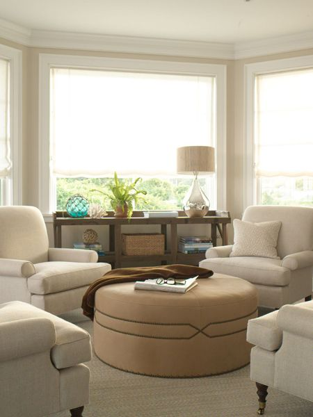 Create a cozy sitting area with grouping of four chairs & round ottoman