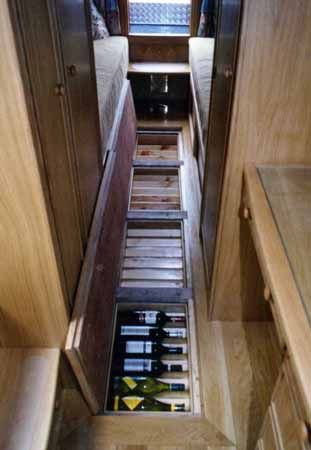 Wine storage for your boat or RV. - Agaiin, gotta love the whole 'under floor storage' thing...   -  To connect with us, and our community of people from Australia and around the world, learning how to live large in small places, visit us at www.Facebook.com/TinyHousesAustralia