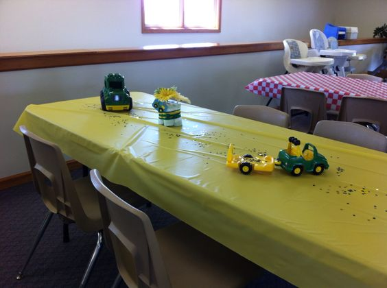 Table decorations of mini diaper cakes tied up with flowers and ribbon. Toy tractors and wagons finished the look -easy. All were cleaned, the ones used for food were lined with zip bags or plastic wrap.