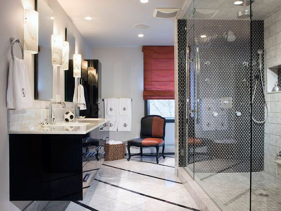 Designer Ana Donohue chose black tiles for the shower and a black lacquer vanity for a contemporary look.