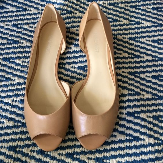 NWT adorable nude peep toe flats NWT Nude Nine West peep toe flats with side cut…