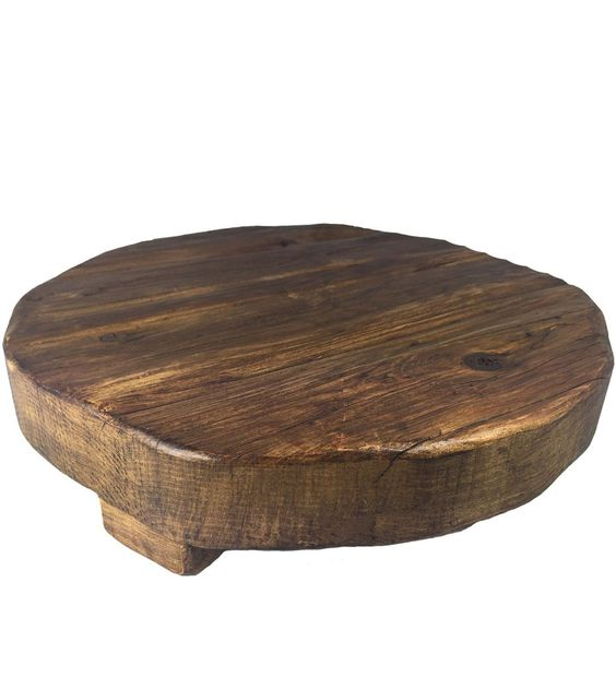 Reclaimed Wood Trivet and Serving Board, Large -- Our Reclaimed Wood Round Trivet is a versatile classic you'll use again and again. Each trivet is hand cut and made of timber from the late 1800s, using Old World tools and techniques. Each piece is hand finished and accented with a galvanized metal band. It's character and charm bears the imperfections of the wood's original context.