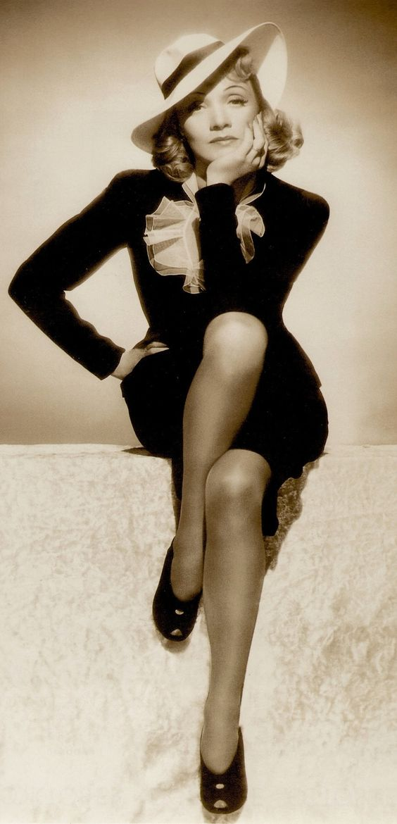 "MARLENE DIETRICH in MANPOWER 1941 photo by Scotty Welbourne. I have a 20"" b/w  statue of this pose called 'Marlene', it's beautiful. It was withdrawn from sale, so is very rare. From a 2001 Marlene Dietrich German calendar. (minkshmink on pinterest):"