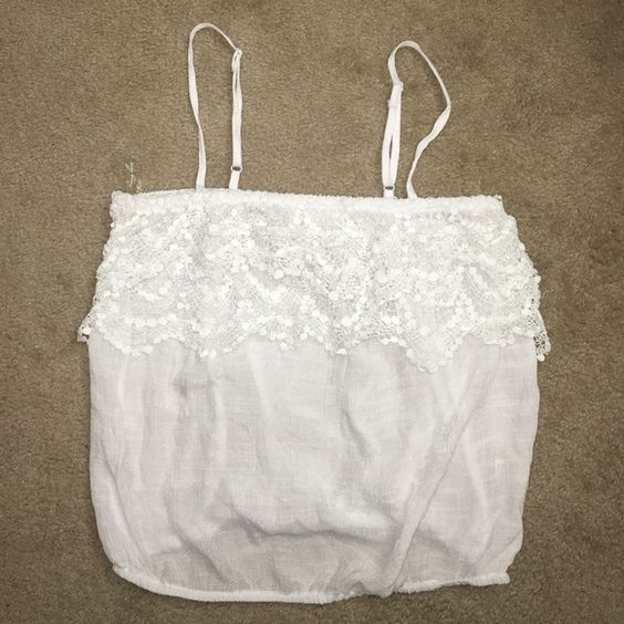 White TOBI top White top NWOT. Ruffling detailing on top with spaghetti straps & a scrunched bottom, allowing it to be worn cropped or as a normal top. Size L, but I'd say fits a medium better. Tobi Tops Tank Tops