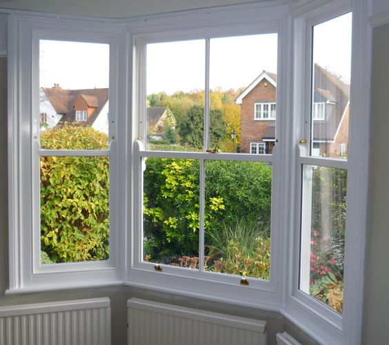 This bay window has been changed from single glazing to for Sash double glazing