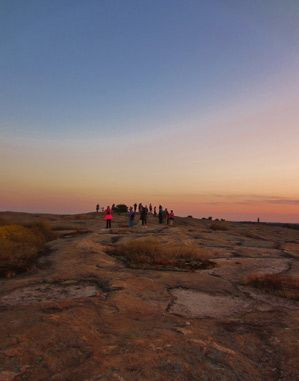 Sunset over the Arabia Mountain National Heritage Area near Atlanta, Georgia. This lunar-like landscape filled with unusual geological formations also has many miles of biking and hiking trails to help you explore  the area.