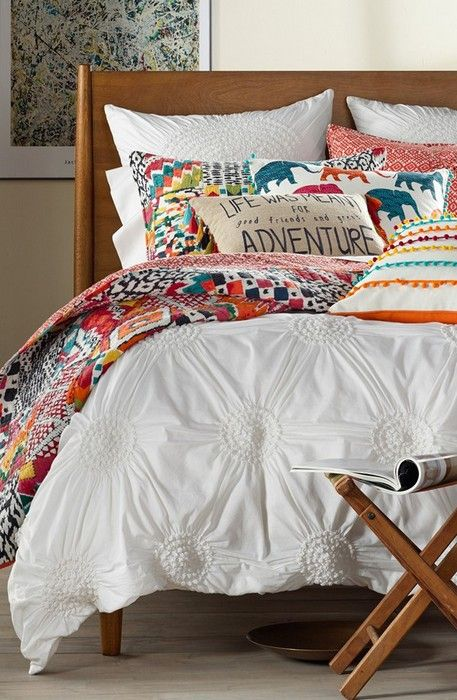 An idea to have a white duvet cover and fold the patchwork quilt for a more subtle splash of color