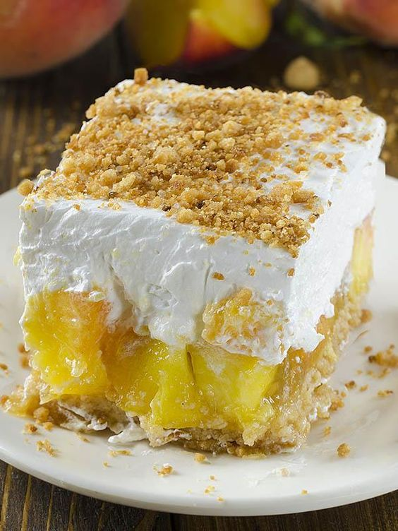 Fresh Peach Delight is a refreshing layered dessert. Graham cracker crust is followed by a layer of fresh peach and jello filling,cream cheese and cool whip