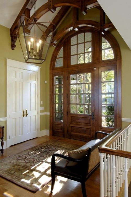 entry, sunlight, love it!..I love awesome foyers..I think I'd change the color of the white doors though I think it ruins the effect of the front door and the color of the walls esp with those brassy handles but then that ties in with the trim and the railings..oh dear...what to do...lol