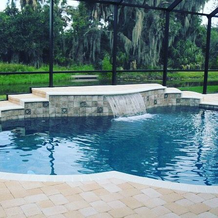 We are all about having a feature focal point! The water feature in this design makes the space - don't you think? #WaterFeature #Design #OlympusPools #PoolDesign #Lakeland #Tampa by olympuspools Creative backyard pool designs.