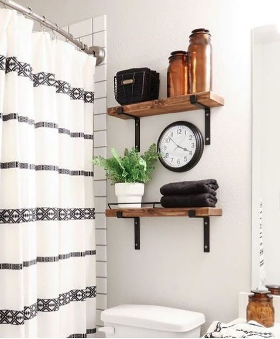 bathroom shelving with wood and metal brackets instead of cabinets above toilet #bathroomideas #bathroomshelves #openshelving #diyshelves