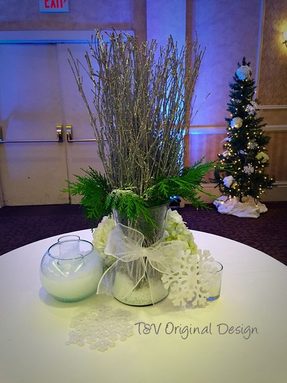 Small table centerpiece for a cocktail table at a winter themed holiday party.