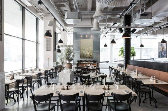 Classic restaurant with an industrial and modern feel. Exposed ducting, built in booths and simple black chairs