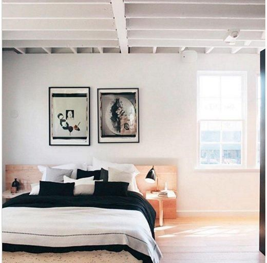 """Monochromatic Minimalist: @csanyi -- Though the room is already #blessed with high ceilings, Niki Csanyi exaggerated the sky-high look by choosing a low-profile bed and anchoring it with a hotel-worthy plethora of decorative pillows on the bed. Instead of stealing this space, we'd prefer to move right in! Shop the pieces you need to get the look and see more bedroom interior design inspiration in """"9 Inspiring Instagram Bedroom Ideas to Steal"""" on the One Kings Lane Style Guide!"""