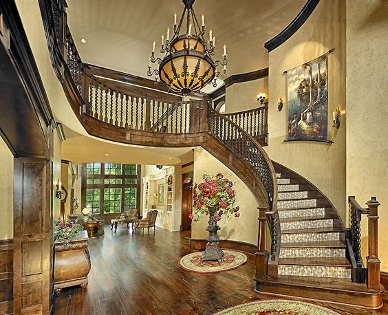 wood floors and a beautiful staircase