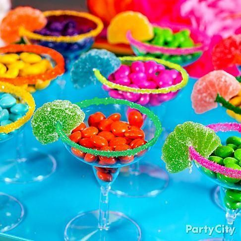 "Serve your guests candy ""margaritas"" in glasses rimmed with sugar and garnished with candy fruit slices for a sweet toast!"
