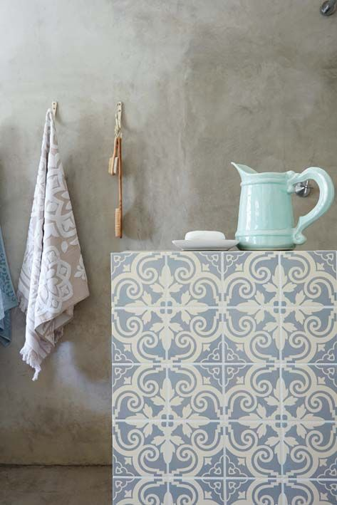 Gorgeous distressed plaster wall, beautiful tile, great styling and muted colors. Image is from Barcelona Tile Designs by Mario Arturo Hernández: