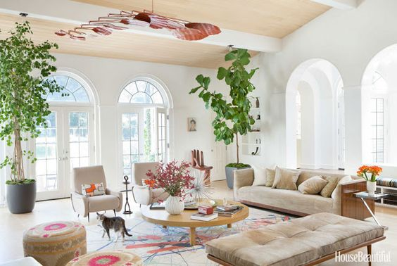 """Another view...From the Coco Cozy blog:  """"...In lieu of a traditional chandelier, the living room features a huge red metal mobile by artist Stephen Oakes, poufs covered in Suzani fabric, decorative pillows made of vintage kimono sashes, a    """"Pollock-esque""""  wool and silk rug, and several pieces of Mid Century Modern-inspired furniture.""""  Published in HB."""