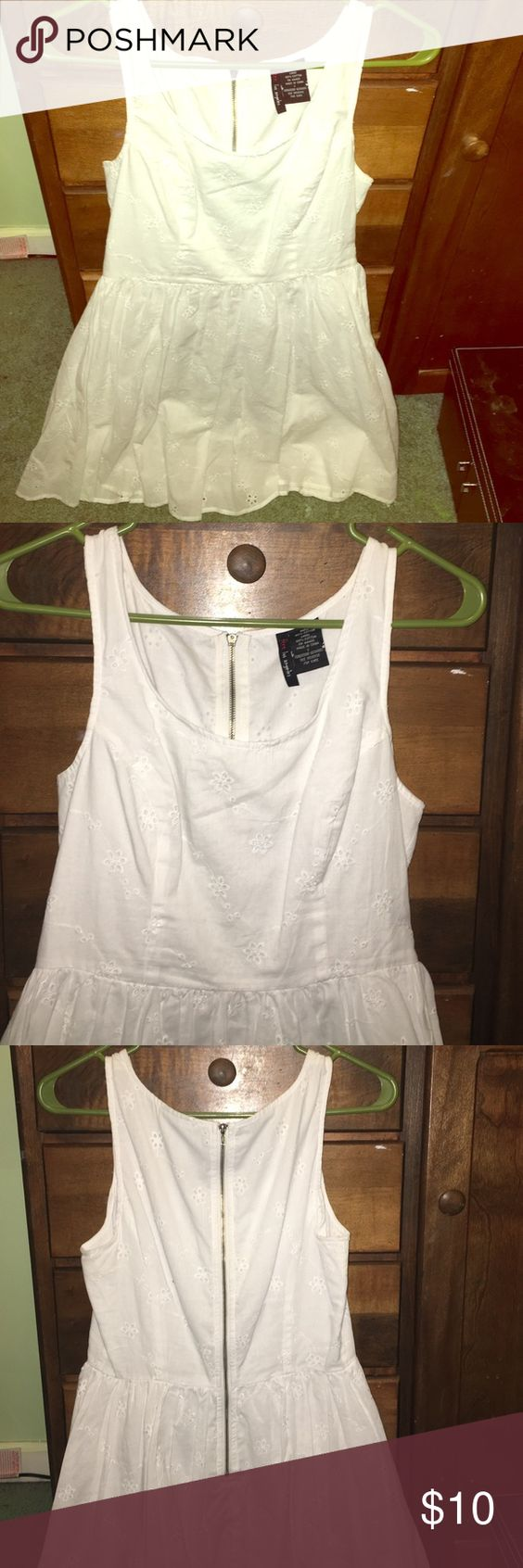 White eyelet dress White tank dress detailed with flowers. Fit and flare style. Dresses Mini