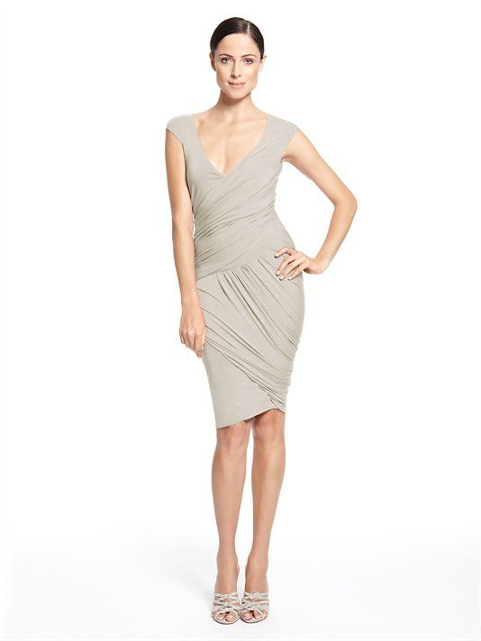 CAP SLEEVE ASYMMETRIC DRAPED DRESS - Donna Karan    •Imported; 94% Viscose/Rayon, 6% Elastane/Spandex
