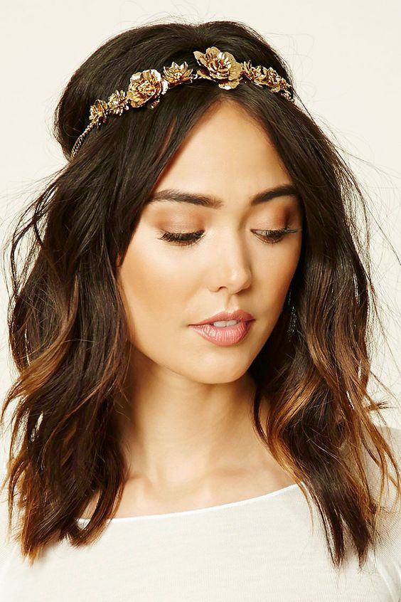 A headwrap featuring metal floral embellishments and an elasticized back.