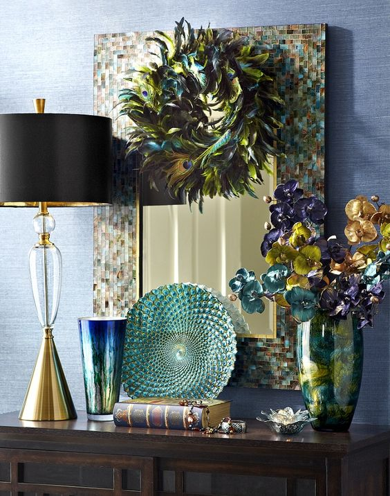 Bring dramatic color and style into your home with the Pier 1 Ocean Mosaic Mirror and Peacock Green Feather Wreath: