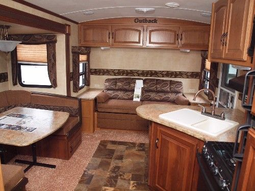 Beautiful interior living inside an Outback 260 FL Travel Trailer