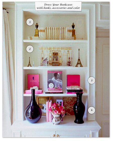 How to Dress Your Bookcase  - Place a book facing out, so that the cover is displayed.