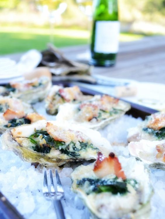 Oysters Rockefeller simply made with creamed spinach, garlic, parmesan cheese and thick cut smokey bacon. 12 minutes in the oven to oyster perfection. | onesimplefeast.com