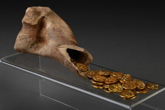 This Iron Age hoard of 32 Gallo-Belgic E gold coins, known as 'staters', was found buried in a cow bone during archaeological excavations at Sedgeford, Norfolk in August 2003. The coins were made by the Ambiani tribe of Gaul in what is now Northern France. The Ambiani fought against Julius Caesar's Roman army. It is believed British mercenaries were also involved in the fighting. After defeat, the mercenaries or even refugee Gauls travelled to East Anglia to escape to safety.
