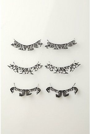 Paperself Paper Lashes by Ting Yu Wang: Oh so fragile and fluttery lashes inspired by Chinese paper-cutting. Choose Horses, Peony or Peach Blossom! Easy to use. $18.