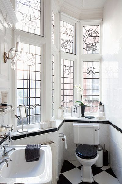 Light-filled black and white bath, gorgeous windows