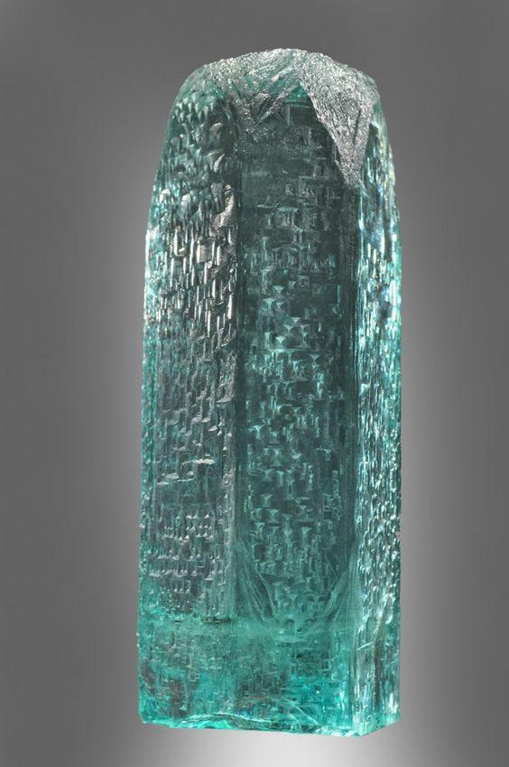 Beryl (Var: Aquamarine) Locality: Minas Gerais, Brazil Specimen from the Munich 2010 Brazilian exhibit. Possibly from Medina. A very gemmy specimen with fine etching, about 25 cm tall.