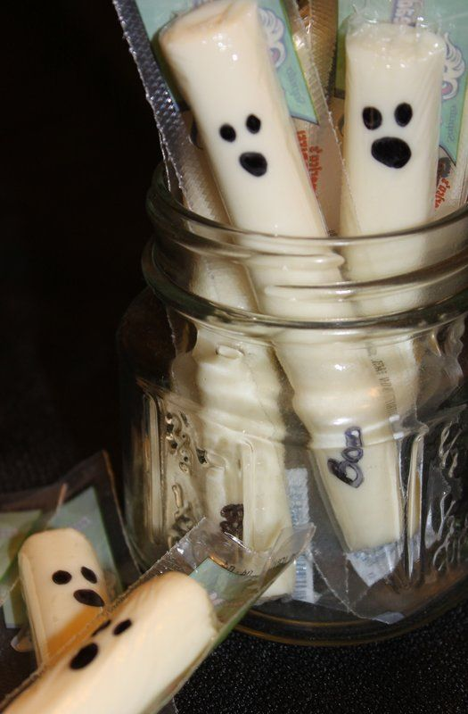 Healthy Halloween Treats - Cheesy Ghost: Nothing can be quicker than this healthy treat. Simply draw a ghost face on a cheese stick with a Sharpie.