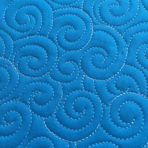 How to Free-Motion Quilt Swirl Designs - closed swirl on weallsew.com