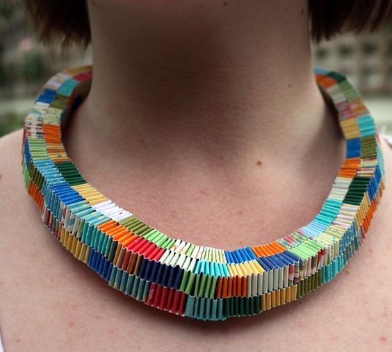 artist makes from new paper, but recycle necklace would be a cool idea