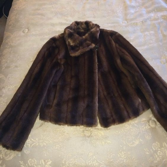 Faux fur Beautiful faux fur  worn twice.  The size is x-small I wear size medium and it fits perfectly. The fur is waist length. Fabulous Furs Jackets & Coats