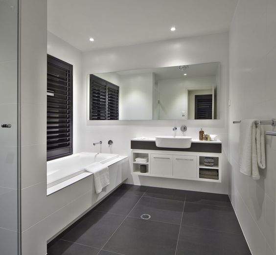 """White bathroom with charcoal floor tiles and Caesarstone """"Snow"""" bench top"""