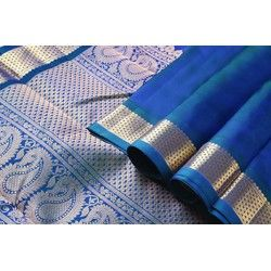 """A #unique #MS Blue with a rich """"arai madam"""" border in the border. The pallu is grand and #lustrous with pure zari - a combination of the #traditional mango and #halfdiamond design! Stunning!"""